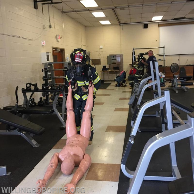 Dragging a 185 pound mannequin 50 feet is part of the SCBA skills course